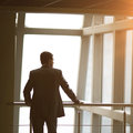 Businessman looking out the window thinking about business ideas Royalty Free Stock Photo