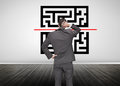 Businessman looking at qr code in an empty room Royalty Free Stock Image