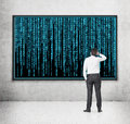 Businessman looking to matrix screen with background Royalty Free Stock Images