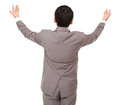 Businessman looks back being lifted hands upwards isolated on white background Stock Photography