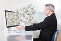 Businessman with lots of cash earning in internet Stock Photo