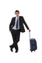 Businessman with luggage stood waiting Royalty Free Stock Image