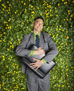 Businessman Lying in Flower Patch Royalty Free Stock Photo