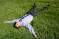 Businessman lying on grass Royalty Free Stock Image