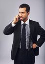 Businessman mad at someone over the phone young professional angry with Royalty Free Stock Images