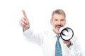 Businessman making an announcement by loudhailer senior executive with megaphone and showing direction Royalty Free Stock Images