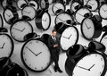 Businessman and many clock standing with phone Royalty Free Stock Photography