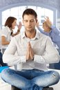 Businessman meditating at office Royalty Free Stock Photo