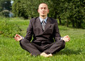 Businessman Meditating Outdoors Stock Images