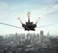 Businessman meditation rope city Stock Image