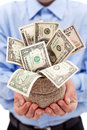 Businessman with money bag full of dollars Royalty Free Stock Photos