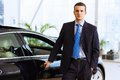 Businessman near car image of handsome young in suit standing Stock Photo
