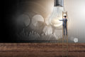 stock image of  The businessman in new idea concept with light bulb