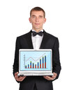 Businessman with notebook in tuxedo holding wirth chart Royalty Free Stock Image