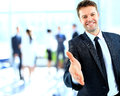 Businessman offering a handshake Royalty Free Stock Photo