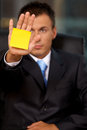 Businessman in office with blank adhesive note stuck to his hand Royalty Free Stock Images