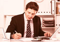 Businessman in office clothes filling up documents Royalty Free Stock Photo