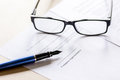 Businessman office desk with contract for signig, glasses and pen Royalty Free Stock Photo