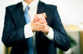 Businessman at the office with his hands folded willingness to friendship and cooperation Royalty Free Stock Images