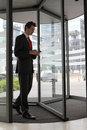 Businessman at office revolving door Stock Photos