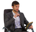 Businessman office sits chair looks aside has control over notebook Stock Photos