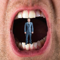 Businessman in open mouth small standing Stock Photos