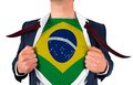 Businessman opening shirt to reveal brasil flag on white background Stock Images