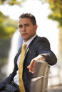 Businessman outdoor handsome sited at the bench park Stock Photography