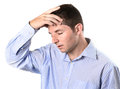 Businessman over worked headache wearing a blue business shirt is and with a on a white background Stock Image