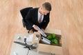Businessman Packing Belongings In Cardboard Box Royalty Free Stock Photo