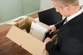 Businessman packing files in cardboard box Royalty Free Stock Photo