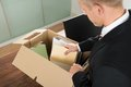 Businessman packing files in cardboard box close up of a at office Royalty Free Stock Photography