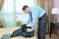 Businessman packing a suitcase Royalty Free Stock Photo