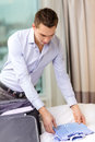 Businessman packing things in suitcase business technology internet and hotel concept happy hotel room Royalty Free Stock Photos