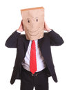 Businessman with a paper bag on head dancing isolated white Stock Images