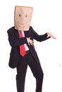 Businessman with a paper bag on head dancing isolated white Royalty Free Stock Images