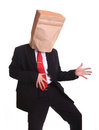 Businessman with a paper bag on head dancing isolated white Royalty Free Stock Photos
