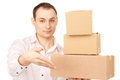 Businessman with parcels picture of over white Stock Photo