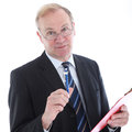 Businessman with pen emphasising a point Stock Images