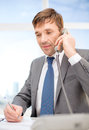 Businessman with phone and documents technology business communication office concept handsome working Stock Image
