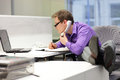 businessman on phone looking at screen - bad sitting posture Royalty Free Stock Photo