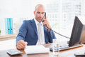Businessman on the phone and writing notes Royalty Free Stock Photo