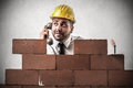 Businessman phoning while building at the phone trying to build a wall Royalty Free Stock Images