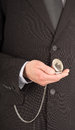 Businessman with a pocket watch in his hand close up of an open Stock Photos