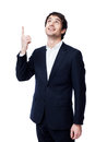 Businessman pointing at copy space handsome and smiling Royalty Free Stock Photo