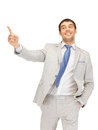 Businessman pointing his finger picture of attractive Royalty Free Stock Photos