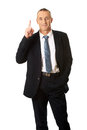 Businessman pointing upwards with one hand Stock Image