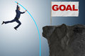 The businessman pole vaulting towards his success goal Royalty Free Stock Photo