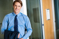 Businessman posing casually at office happy young smiling relaxed Stock Photography