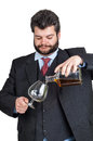 Businessman pouring  a glass of whisky Royalty Free Stock Photos